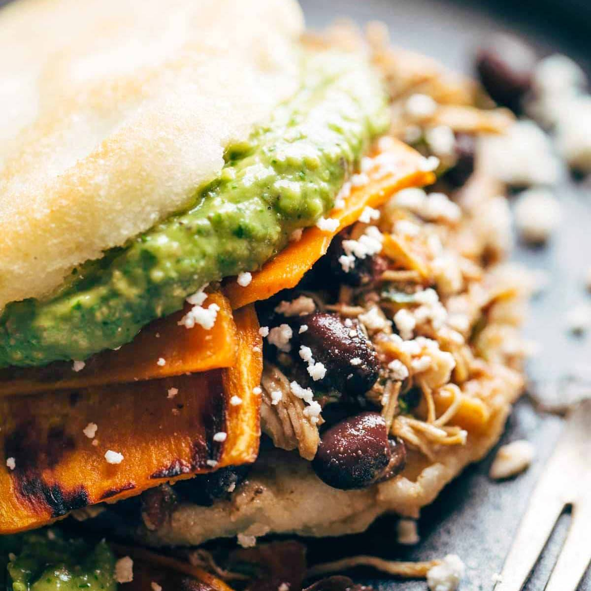 Arepas with sweet potato, carnitas, and black beans.