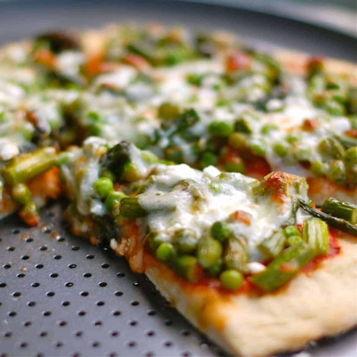Asparagus, peas, and goat cheese pizza is a unique and delicious combination of flavors to bring some variety into your pizza selection. | pinchofyum.com