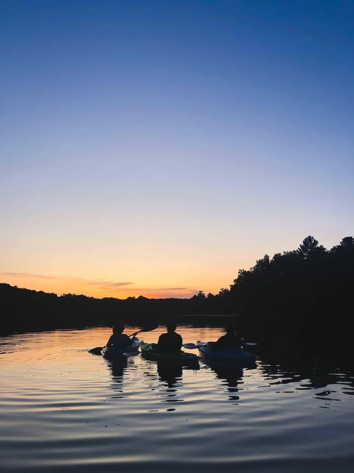 Kayaking at sunset.