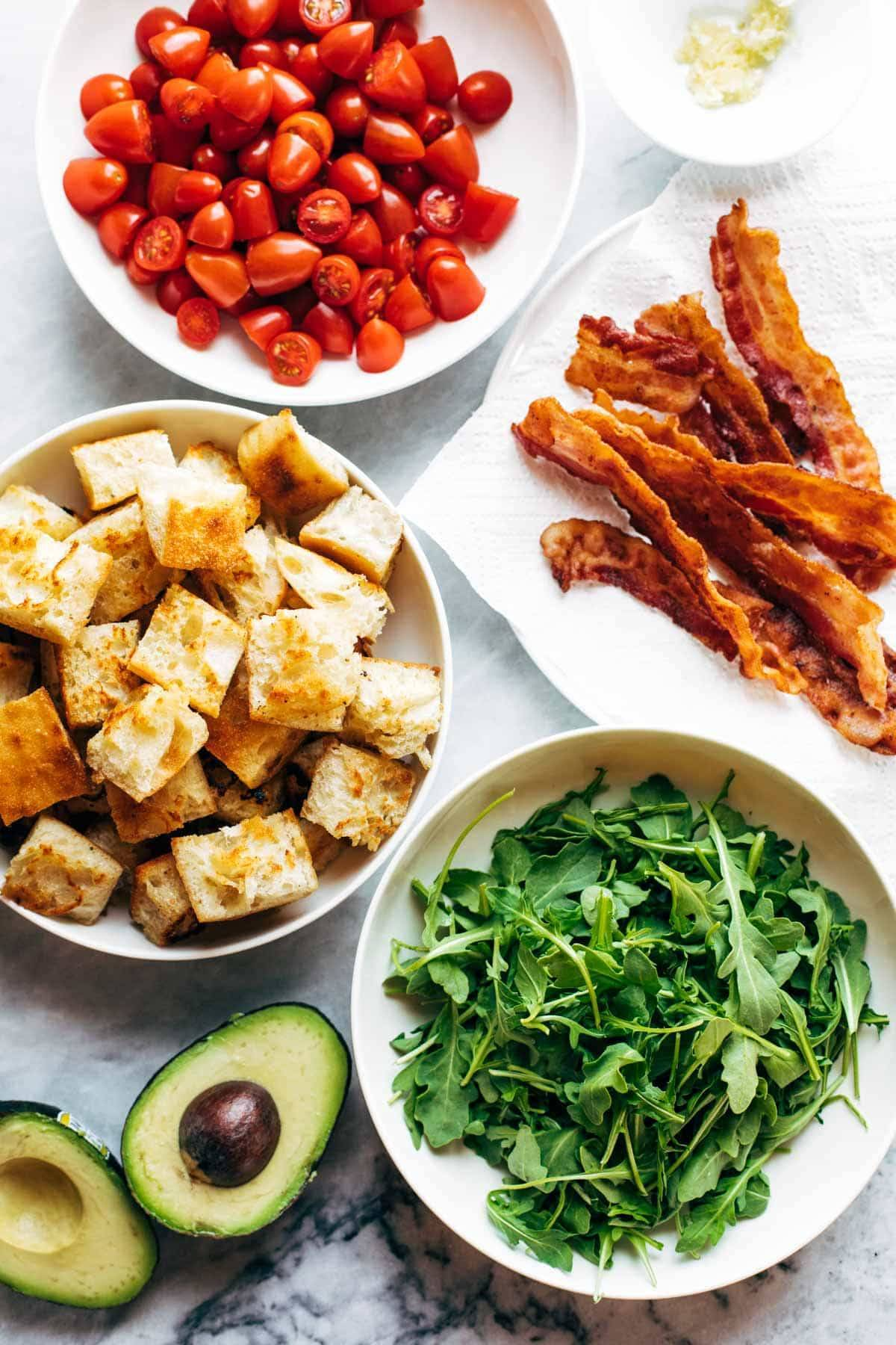 Ingredients for BLT Panzanella in bowls.