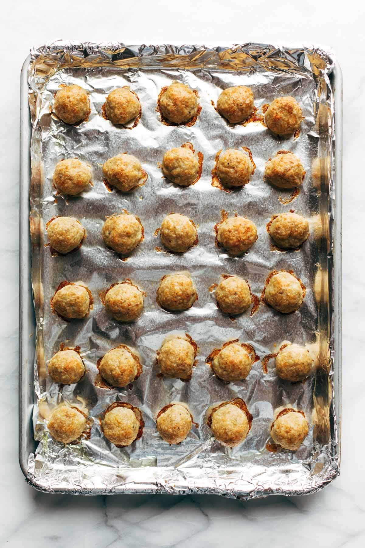 Baked Chicken Meatballs on a sheet pan.