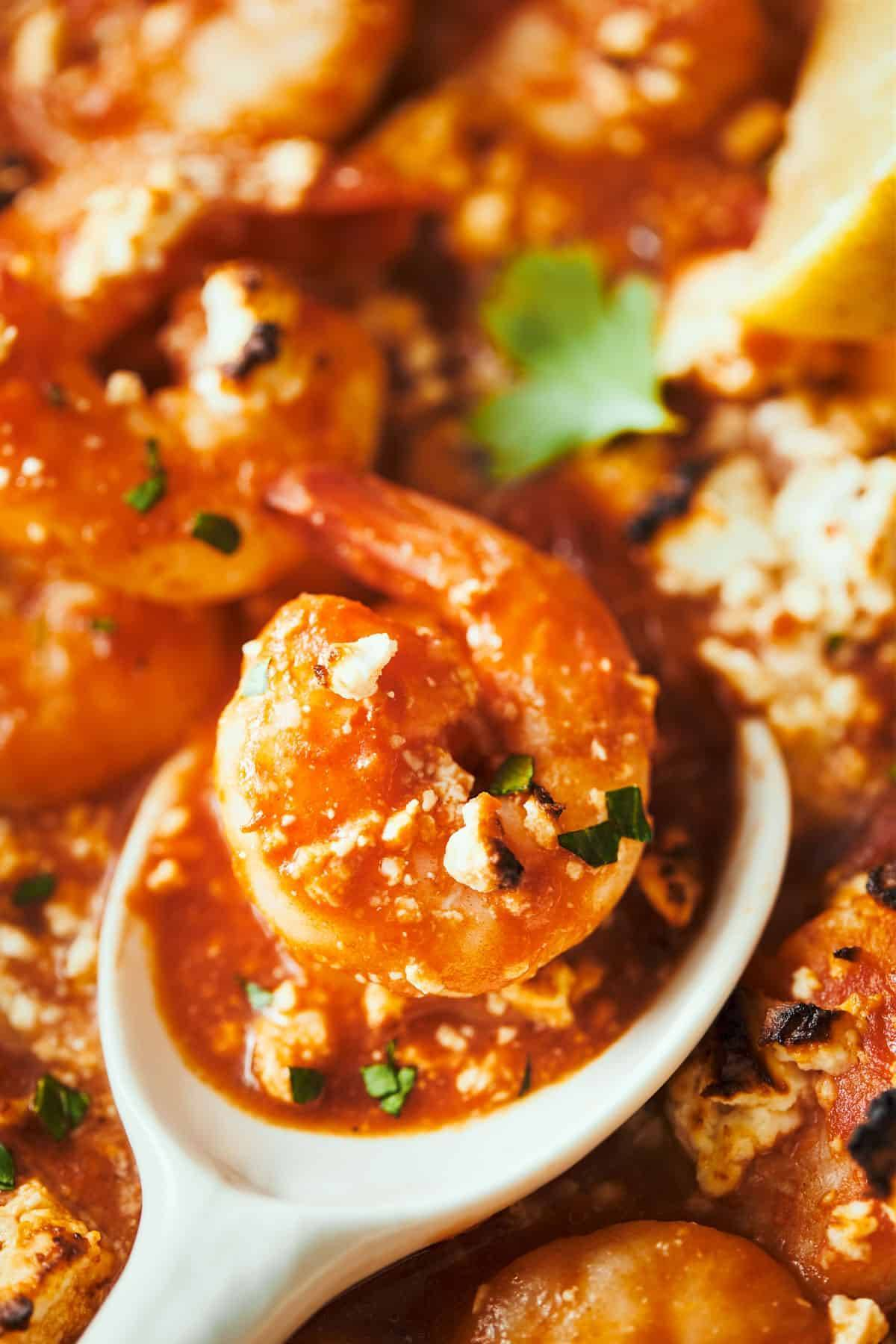 Shrimp in sauce with feta.