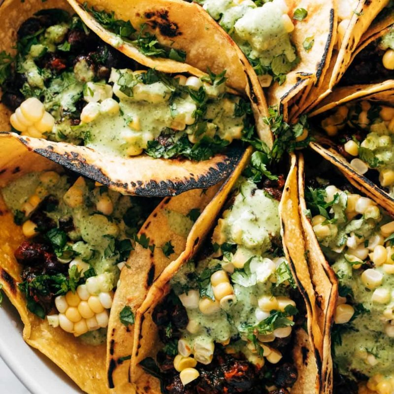 A picture of Smoky Beans & Greens Tacos with Aji Verde