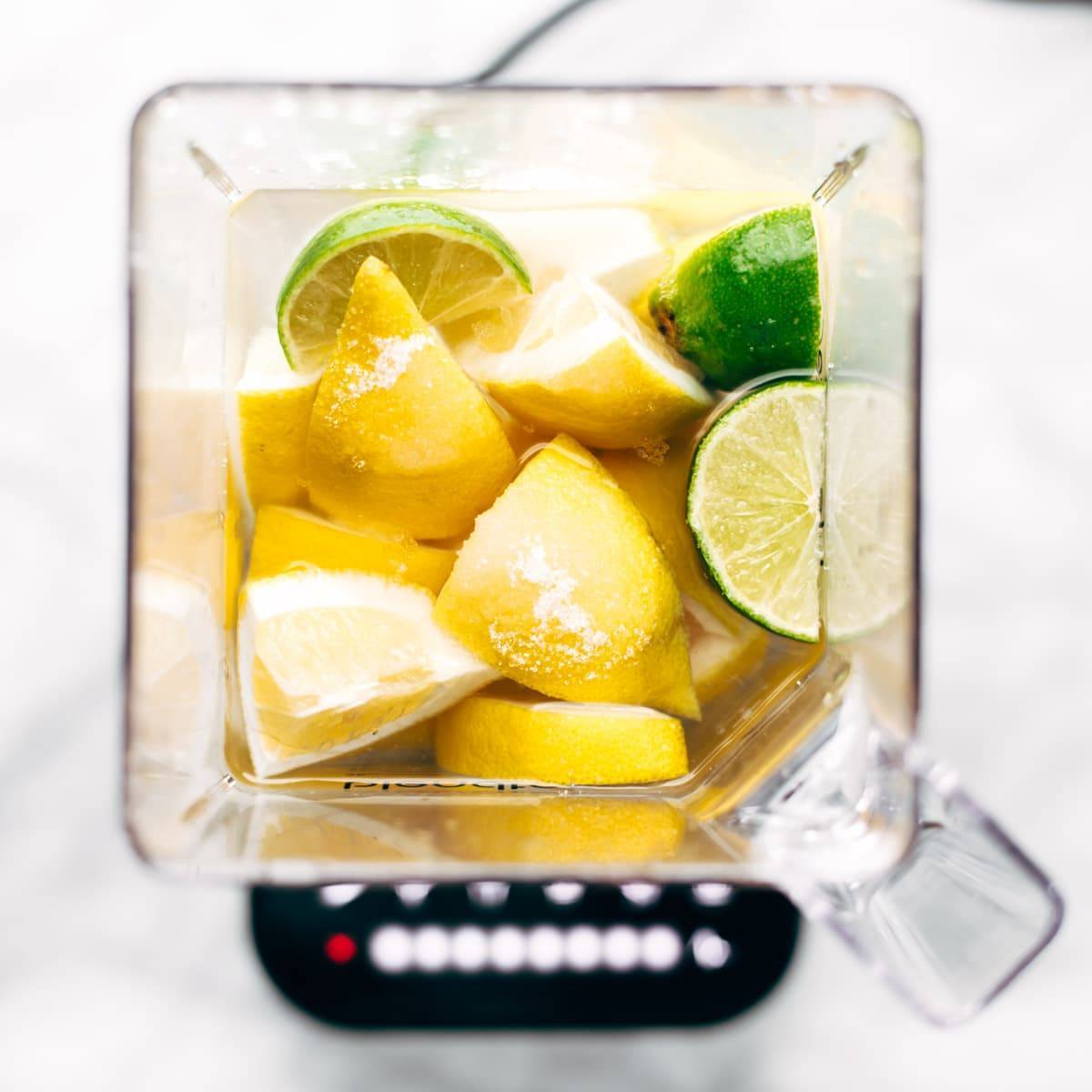 Blender filled with lemons and limes.