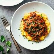 Crockpot Braised Beef Ragu with Polenta in a bowl.