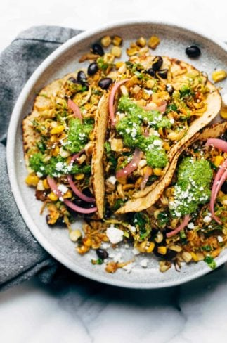Brussels sprouts tacos on plate with toppings.