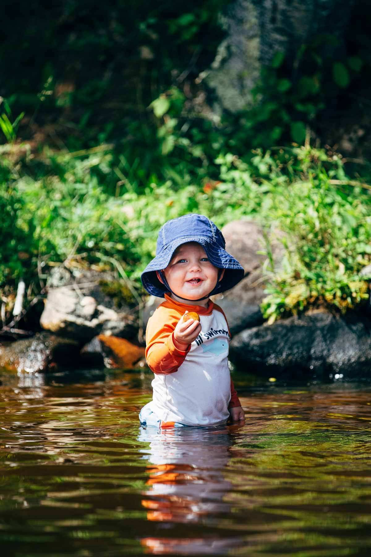 Toddler wearing a sun hat.