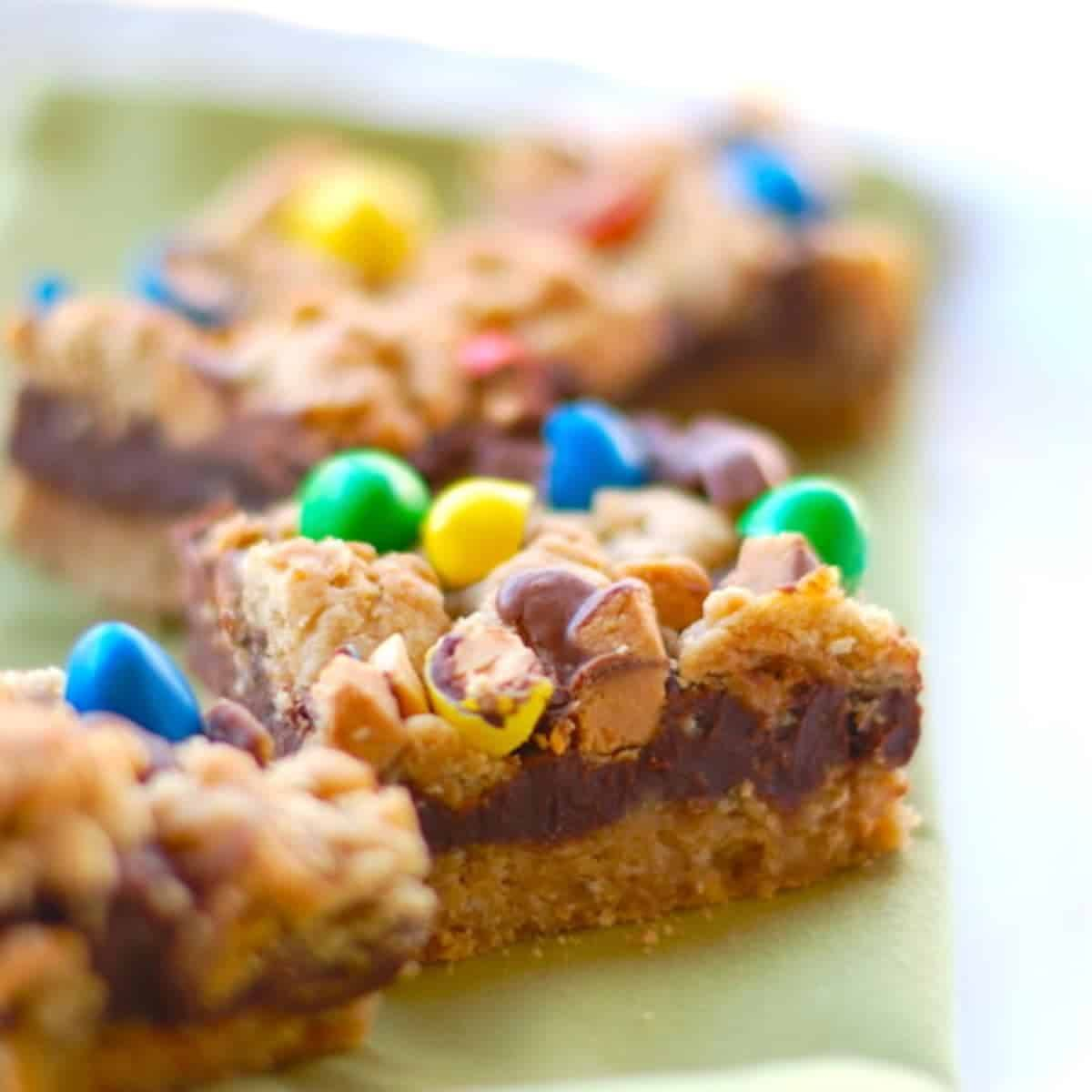 These candy fudge bars are a classic in my family - the thick layer of chocolate fudge in the middle and the candy on top is always a winner. | pinchofyum.com