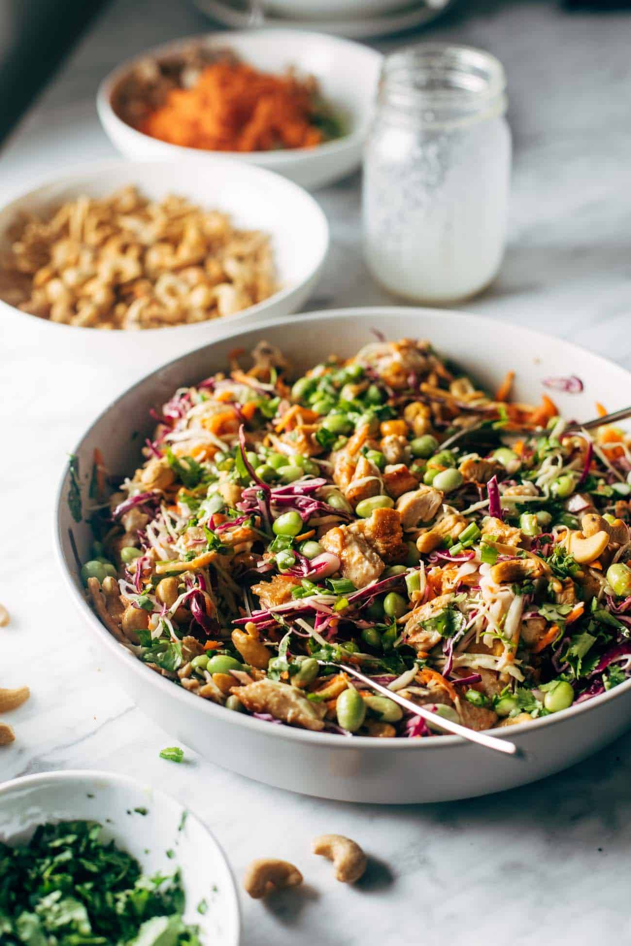 Cashew Crunch Salad in a bowl with a spoon.