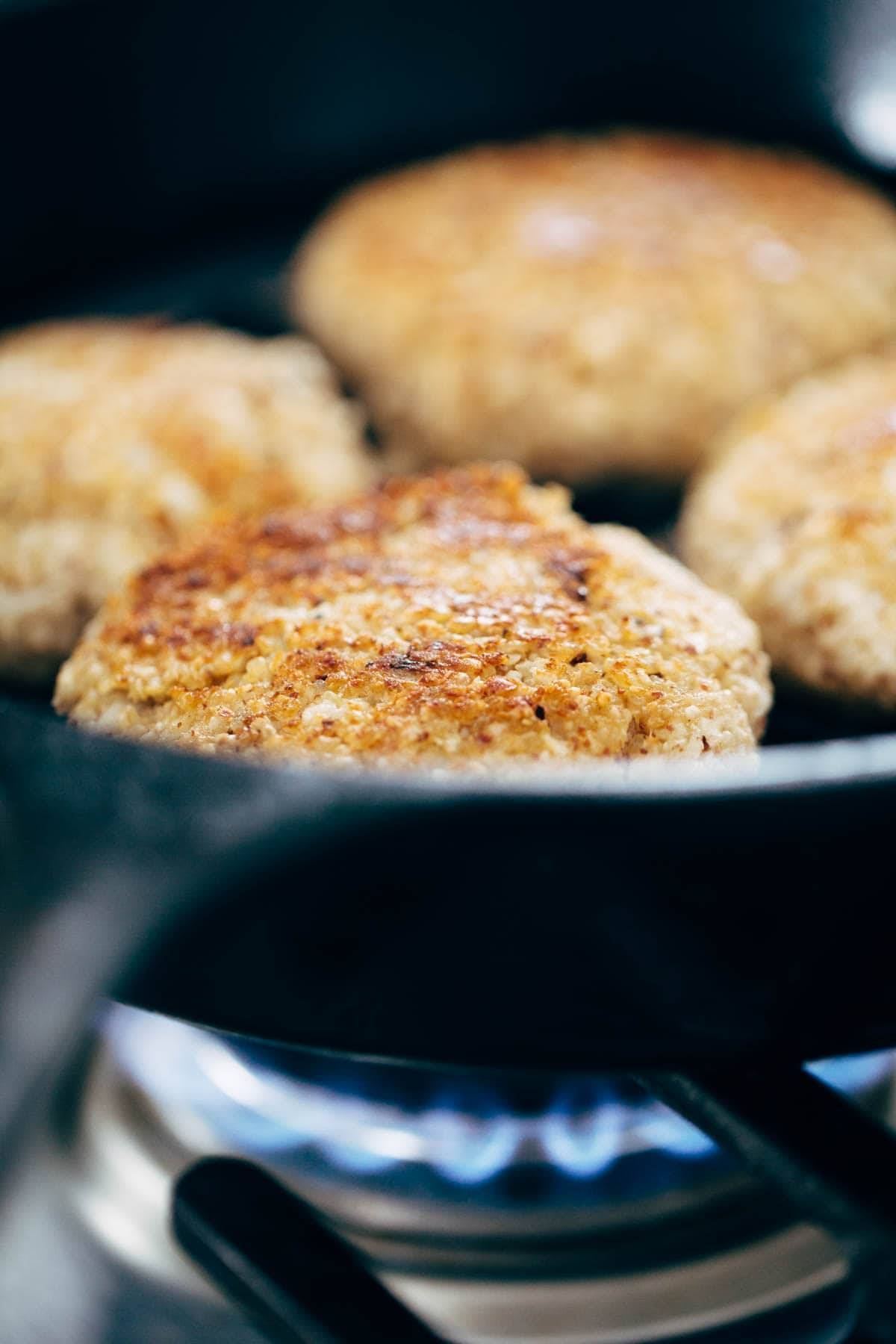 Recipe for Spicy Cauliflower Burgers with avocado sauce, cilantro lime slaw, and chipotle mayo! Meatless, filling, and delicious!   pinchofyum.com