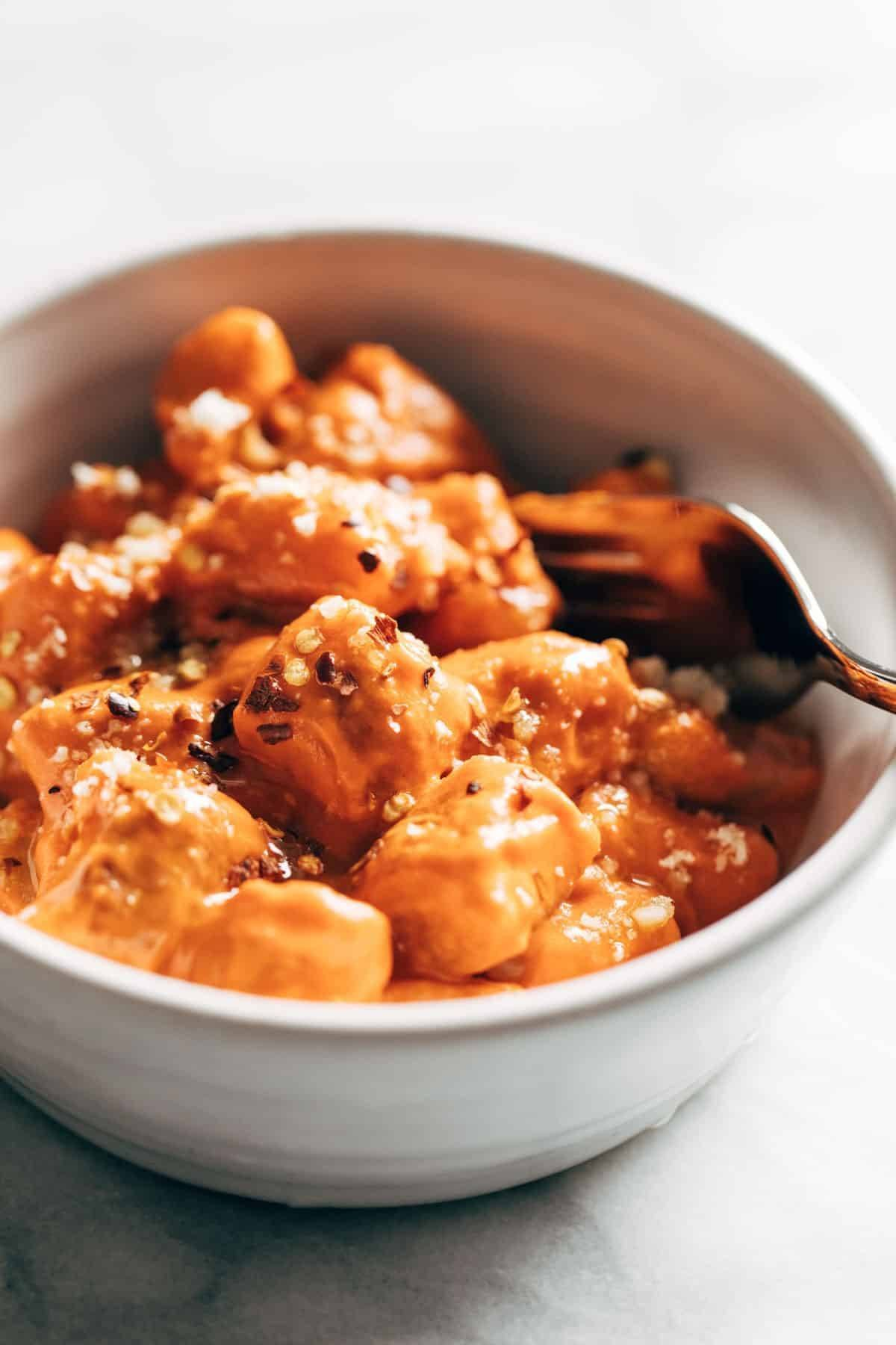Cauliflower gnocchi with vodka sauce in a bowl.