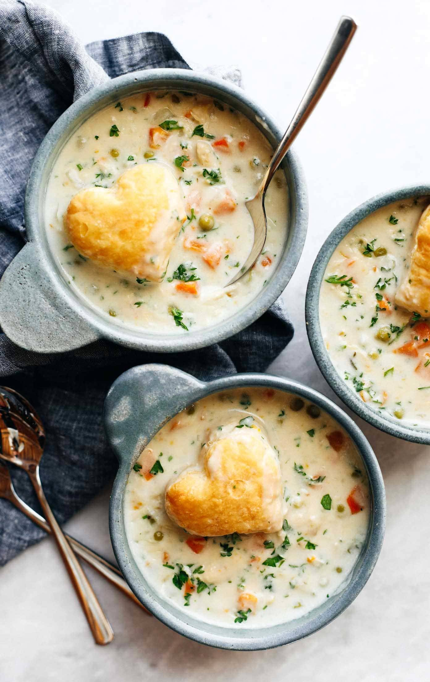 Slow Cooker Chicken Pot Pie Soup in bowls with puff pastry hearts.