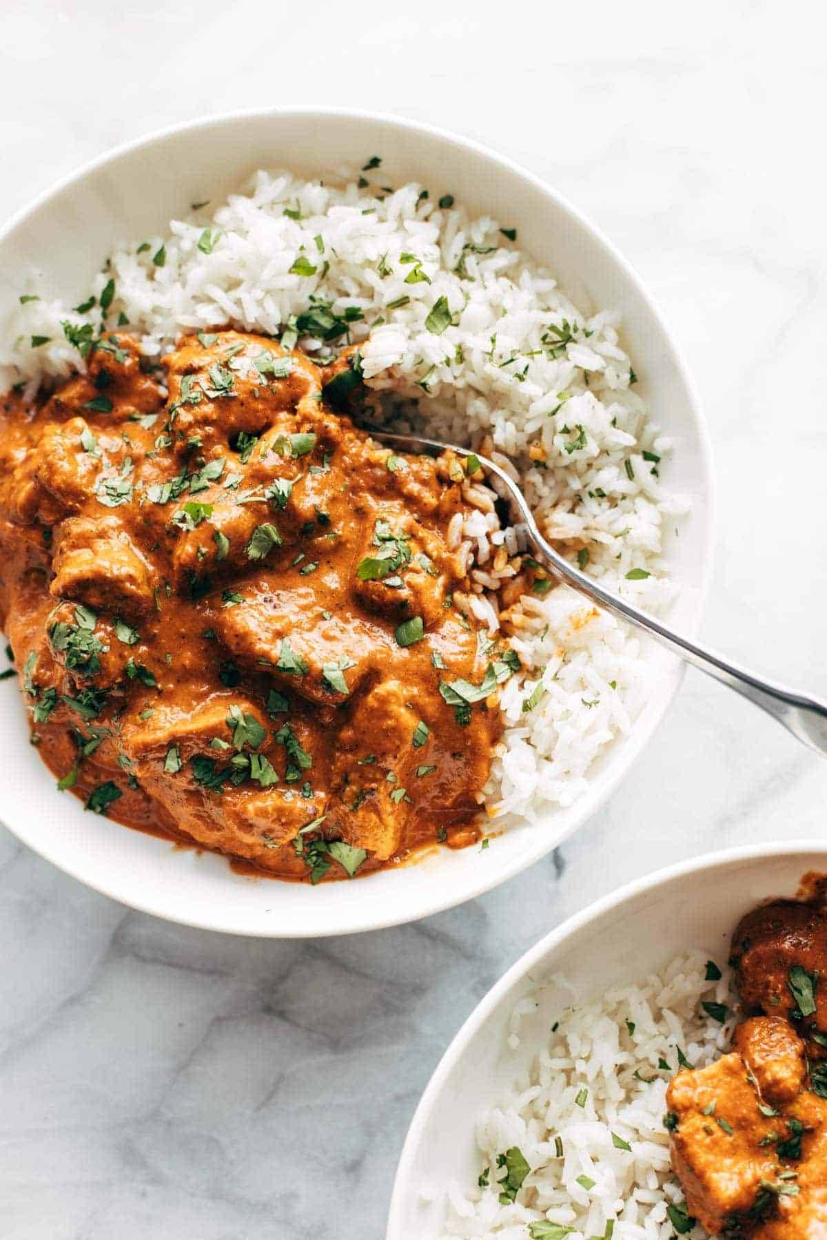 Chicken tikka masala in a bowl with rice.
