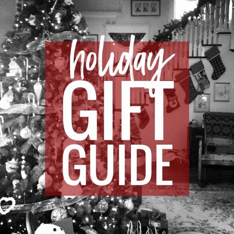 """Christmas scene with """"holiday gift guide"""" text."""