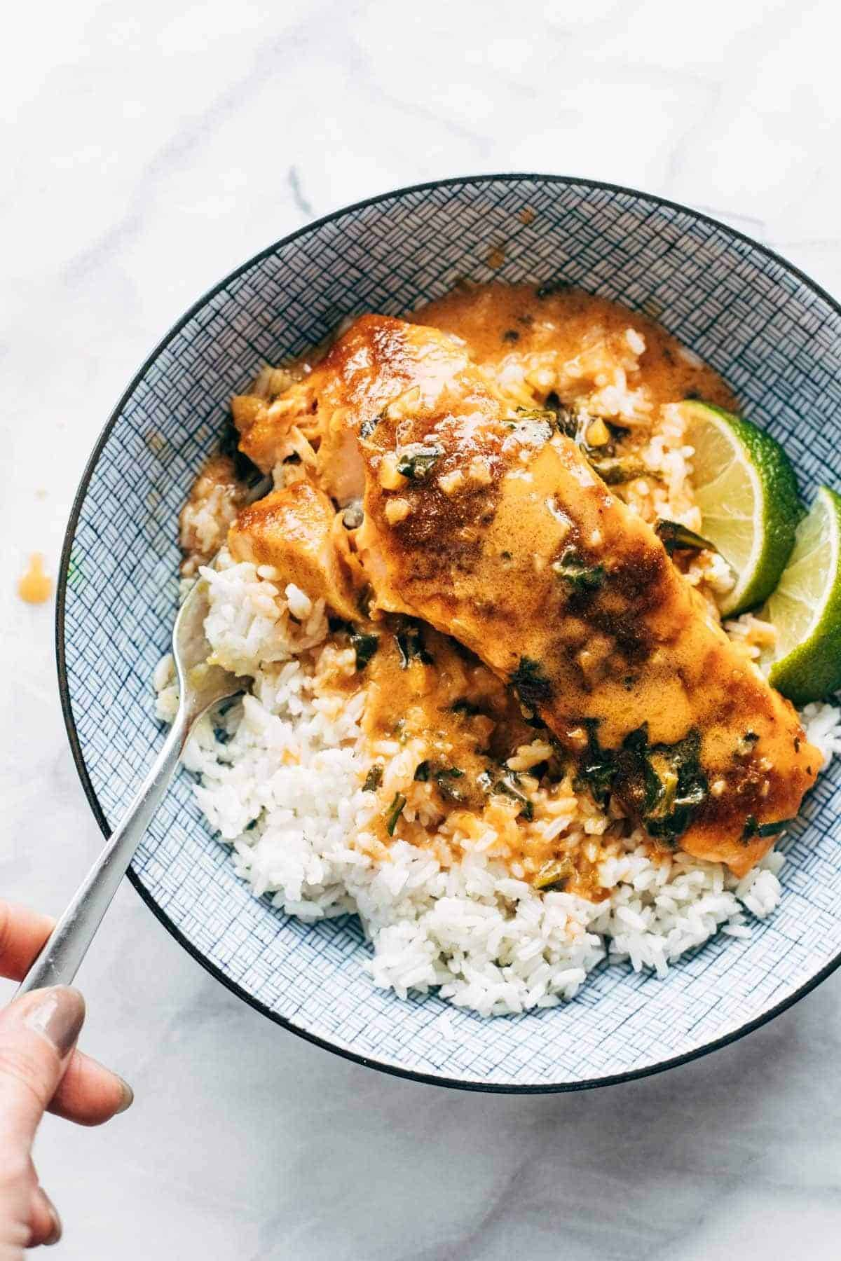 Coconut Curry Salmon with rice in a bowl.
