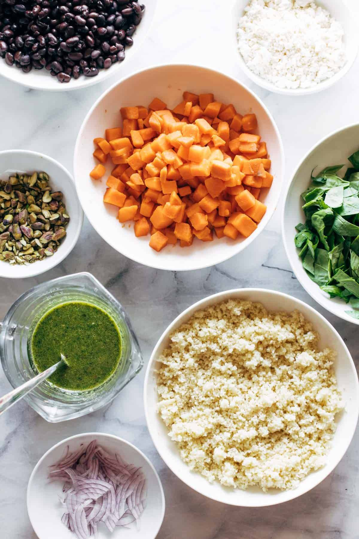 Ingredients in bowls for couscous salad.