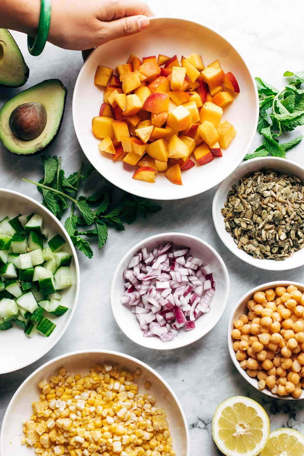 Ingredients for couscous summer salad in bowls.
