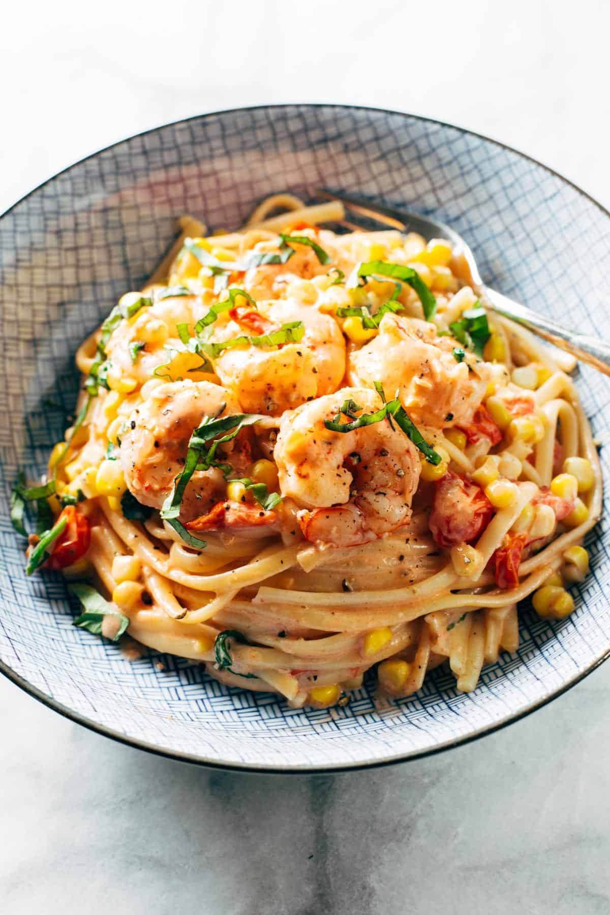 Creamy shrimp pasta in a bowl.