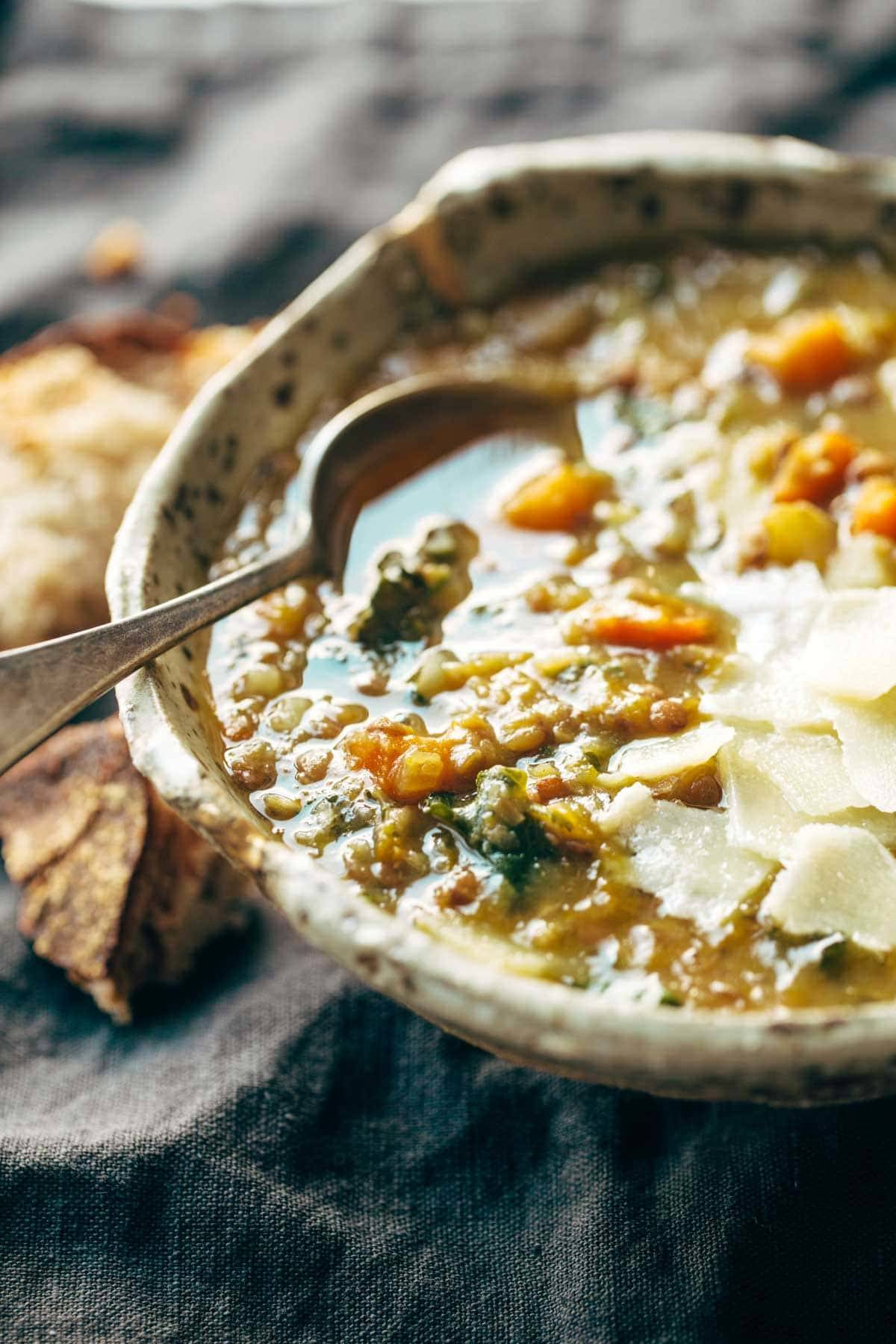 lentil soup in a bowl with a spoon