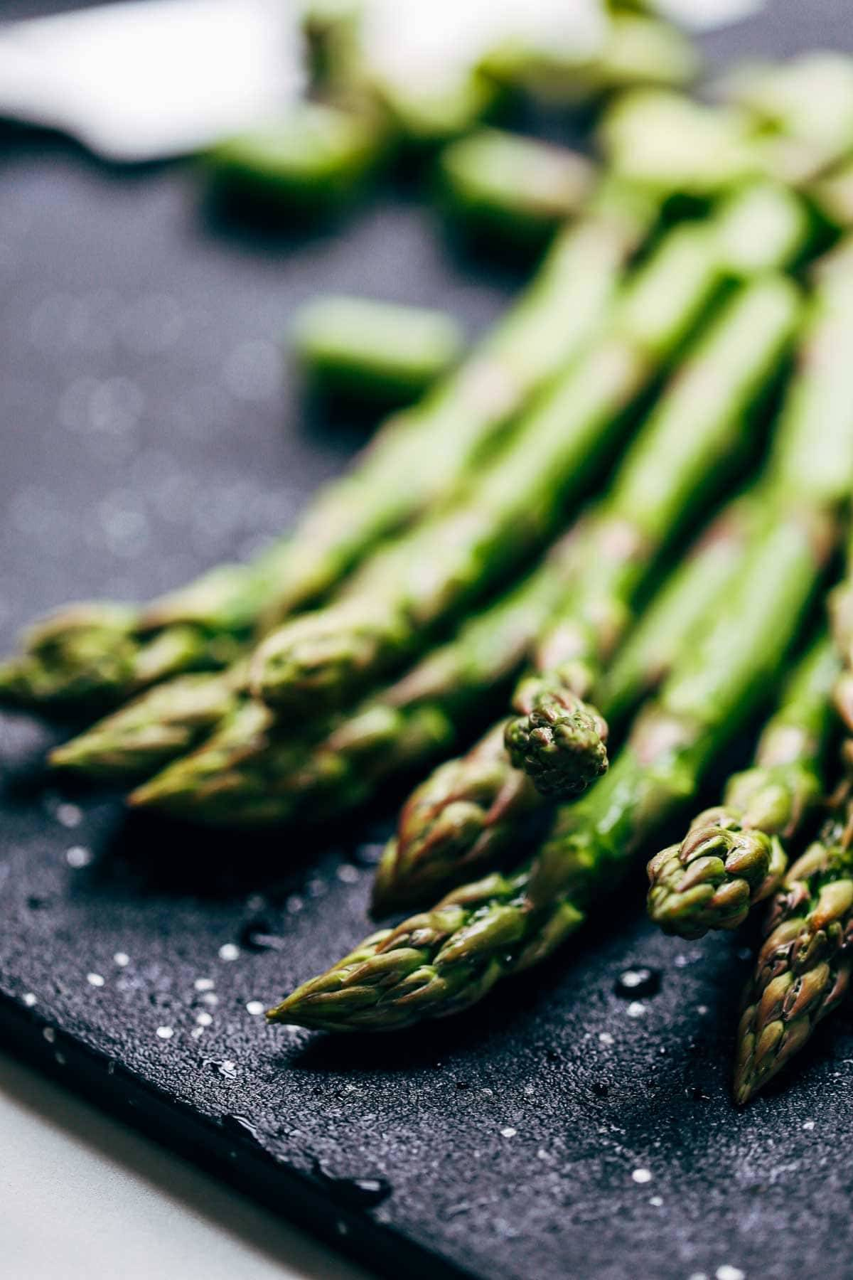Asparagus on a cutting board.