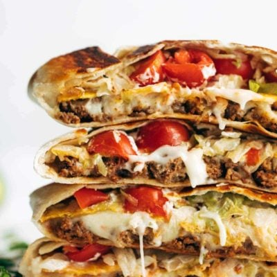 Crunchwrap Supremes in a stack.