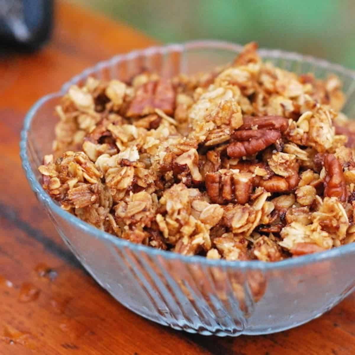 Pecan granola in a decorative glass bowl.