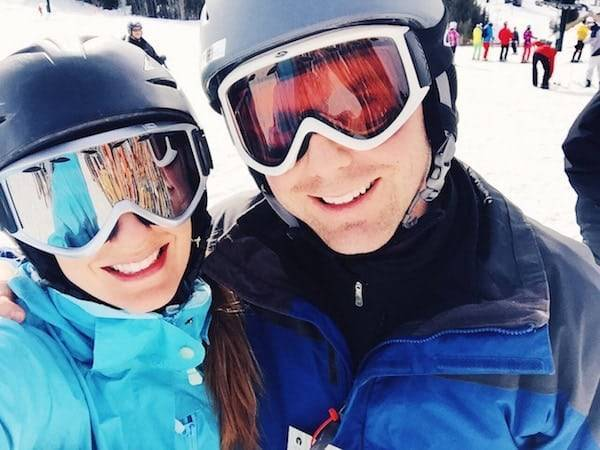 Man and woman wearing ski helmets.