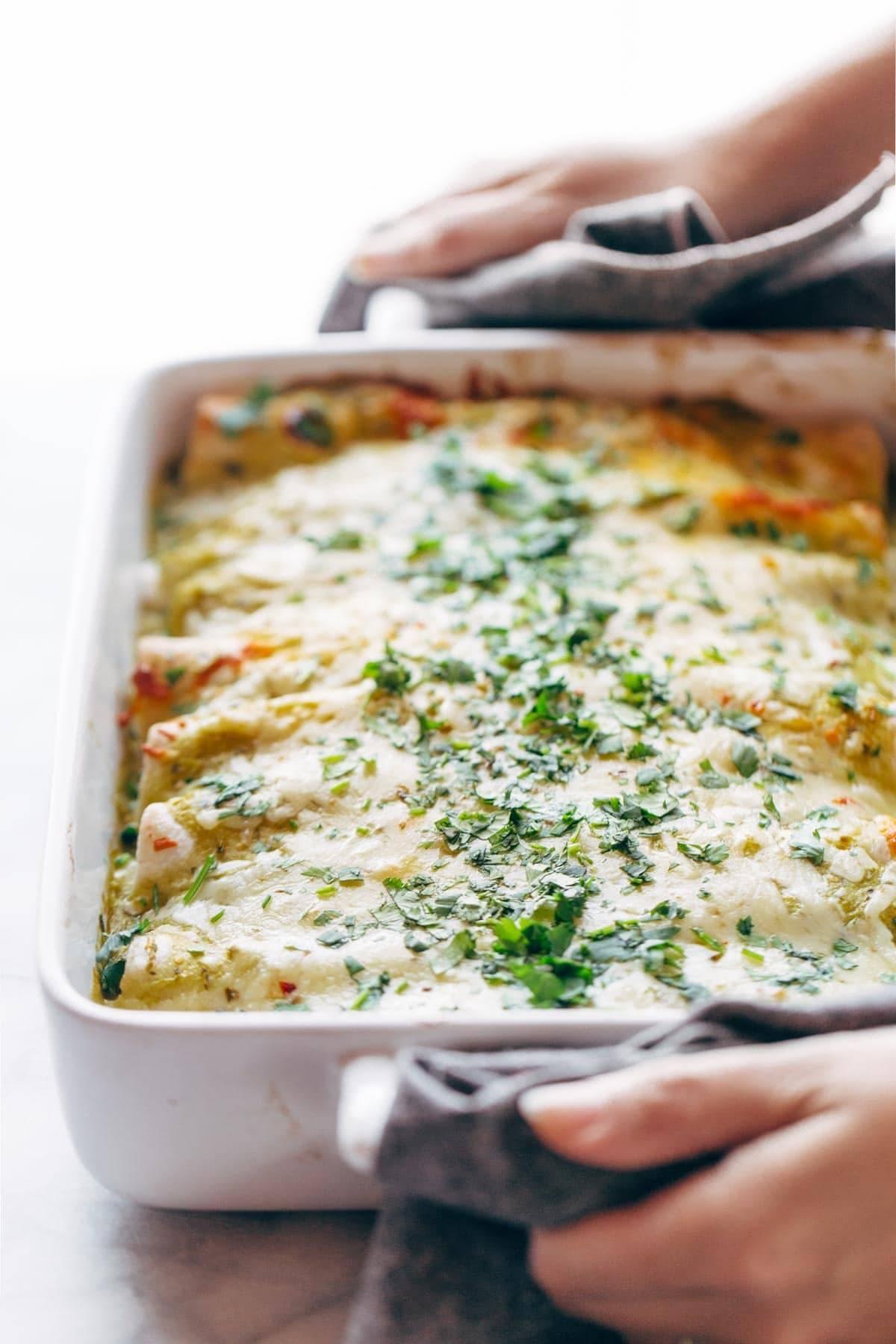 Enchiladas Verdes in a white baking dish.