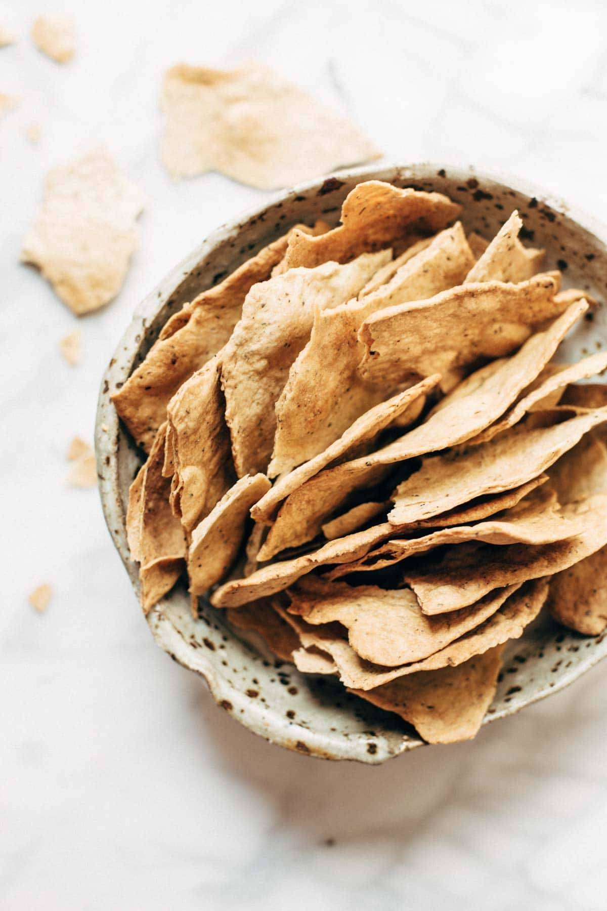 Easy homemade flatbread crackers recipe pinch of yum flatbread crackers in a speckled bowl solutioingenieria Images