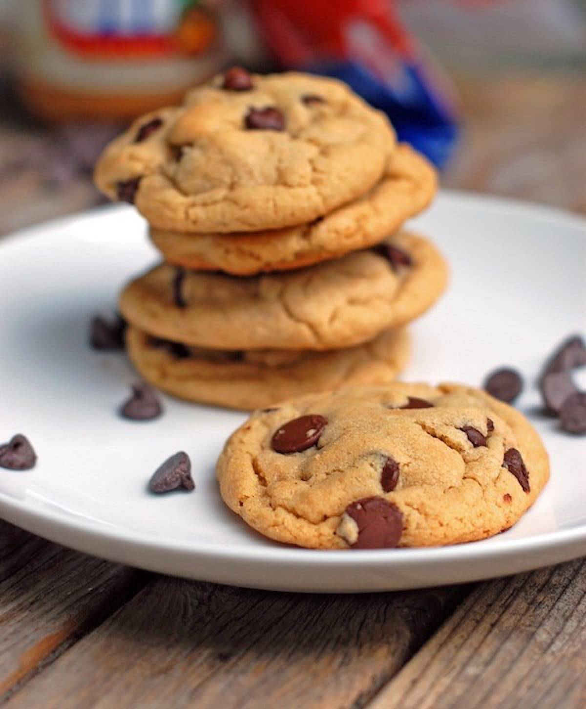 Peanut Butter Chocolate Chip cookies on a plate with chocolate chips.