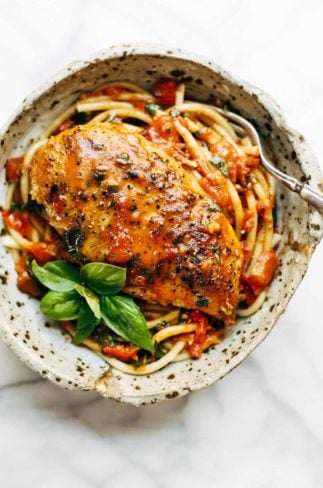 Garlic Basil Chicken in a bowl with pasta and basil.