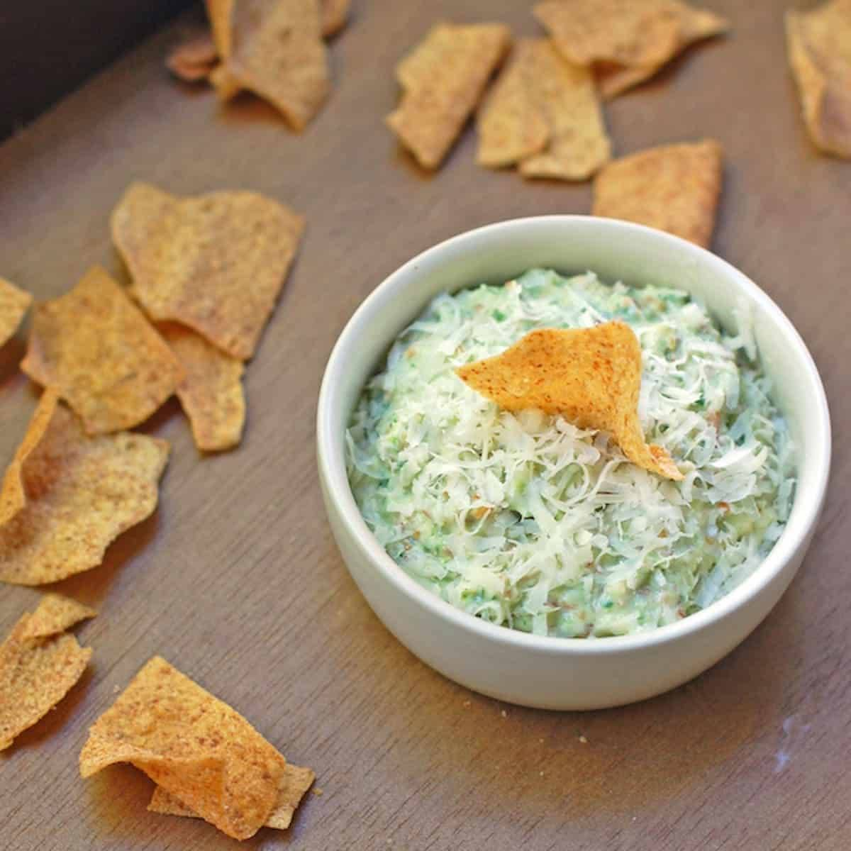 Creamy garlic scape dip with chips.
