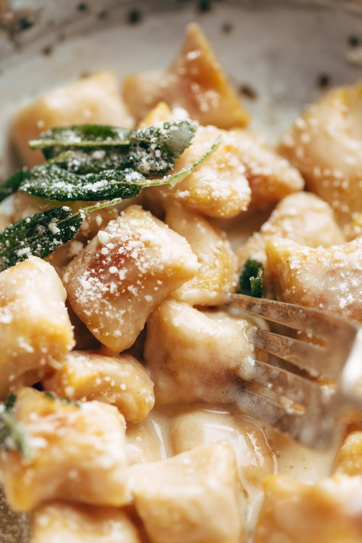 Pumpkin Gnocchi! So incredibly pillowy and delicious. Topped with a 5 ingredient sage garlic butter sauce that will blow your mind. | pinchofyum.com