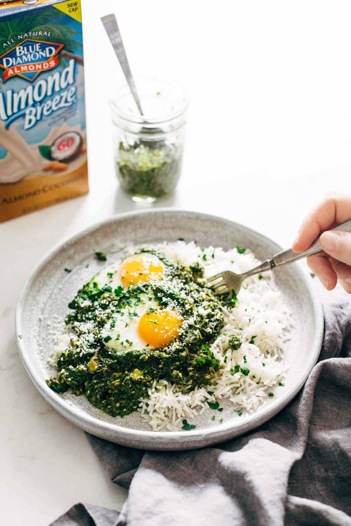 Creamy Green Shakshuka with Rice - 30 minute recipe made with cilantro, parsley, jalapeño, olive oil, almond milk, eggs, and rice. Breakfast, lunch, OR dinner! | pinchofyum.com