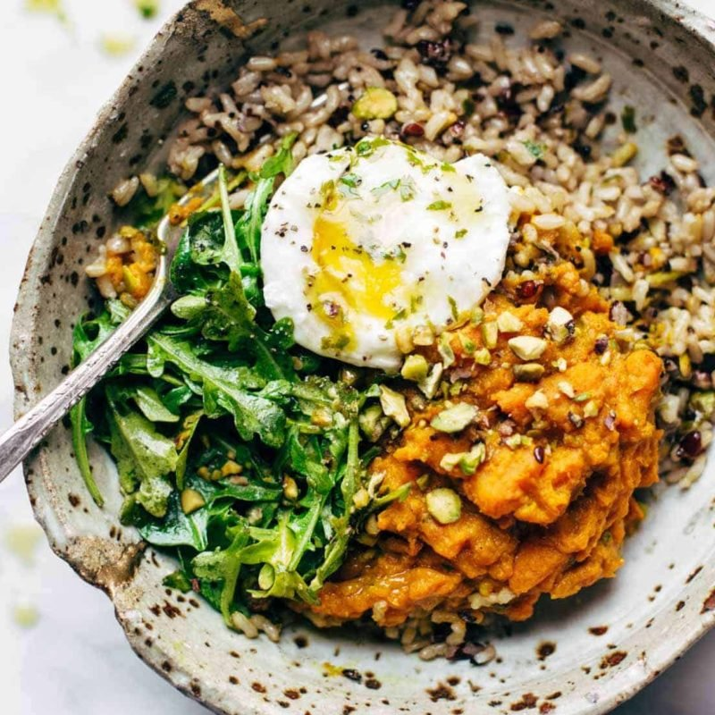 A picture of Healing Bowls with Turmeric Sweet Potatoes, Poached Eggs, and Lemon Dressing