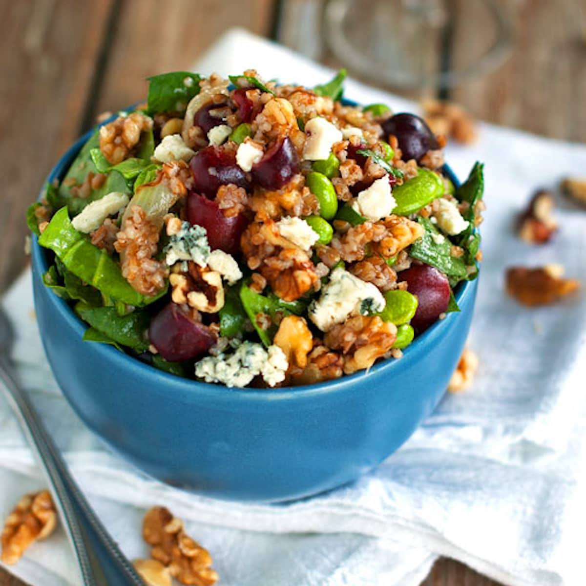 This honey walnut power salad is completely loaded with good stuff: edamame, grapes, blue cheese, bulgur, walnuts, spinach, and honey. | pinchofyum.com