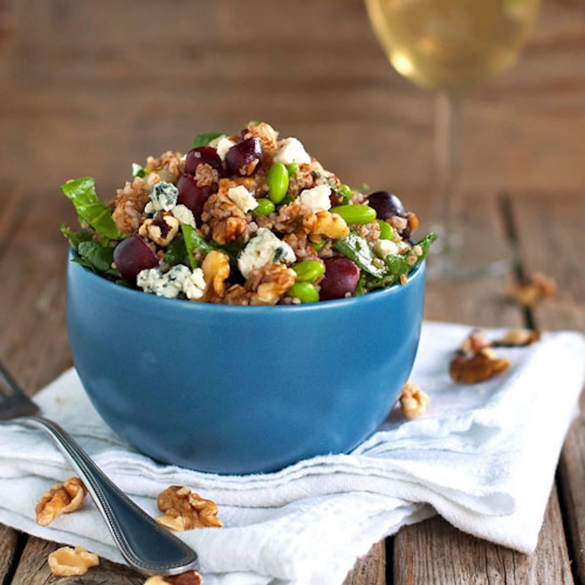 Honey walnut power salad in a blue bowl.