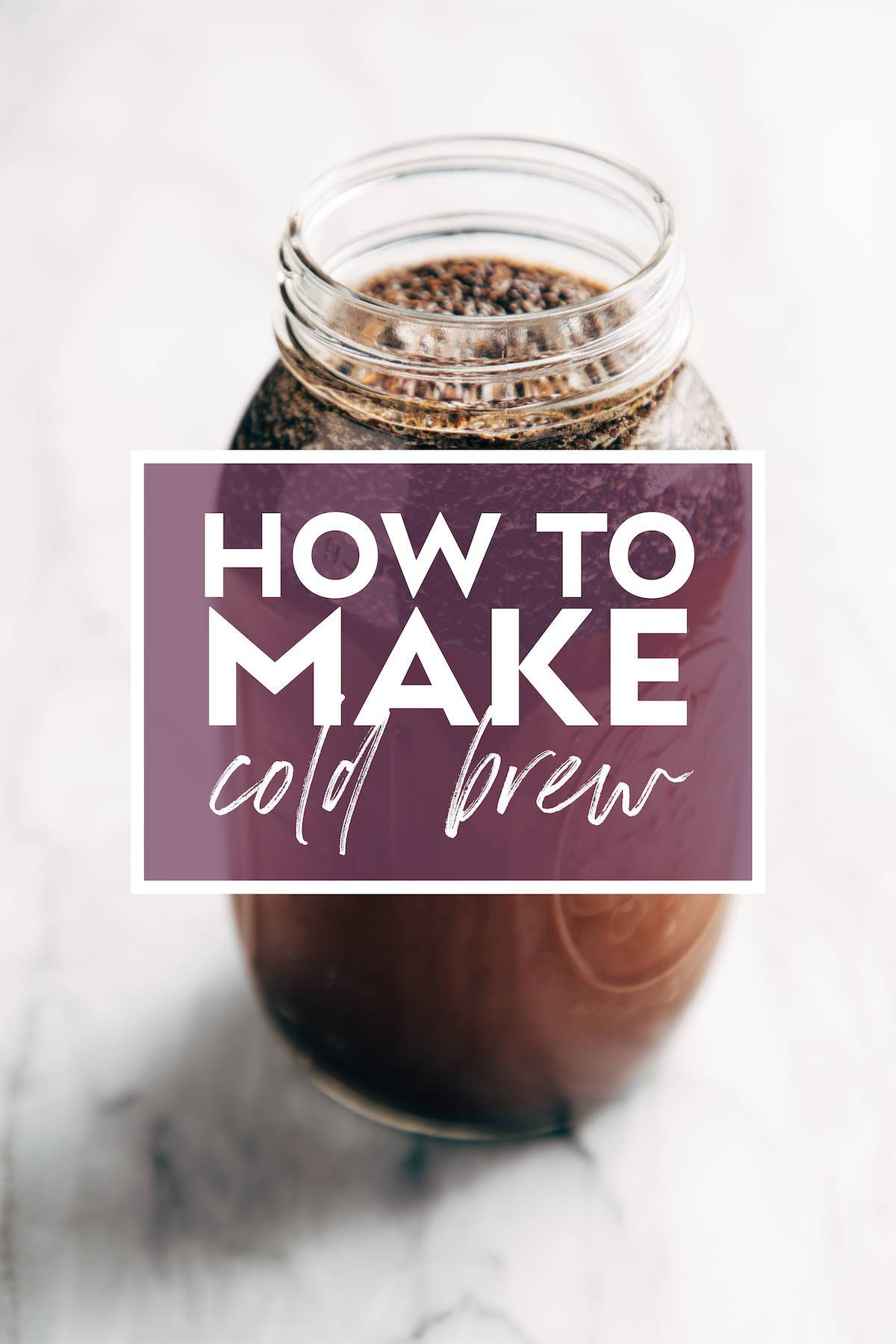 """Image of a mason jar filled with coffee grounds and water steeping to make cold brew. There's text over the jar that says """"How to Make Cold Brew"""""""