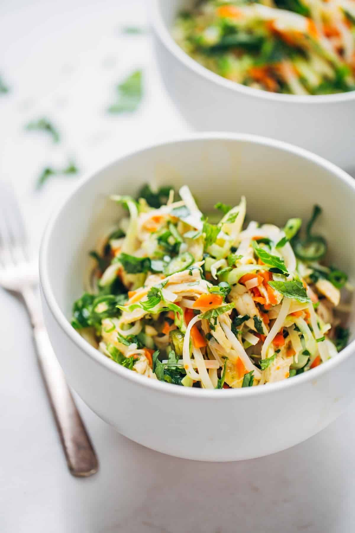 Vietnamese Chicken Salad with Rice Noodles in a white bowl.