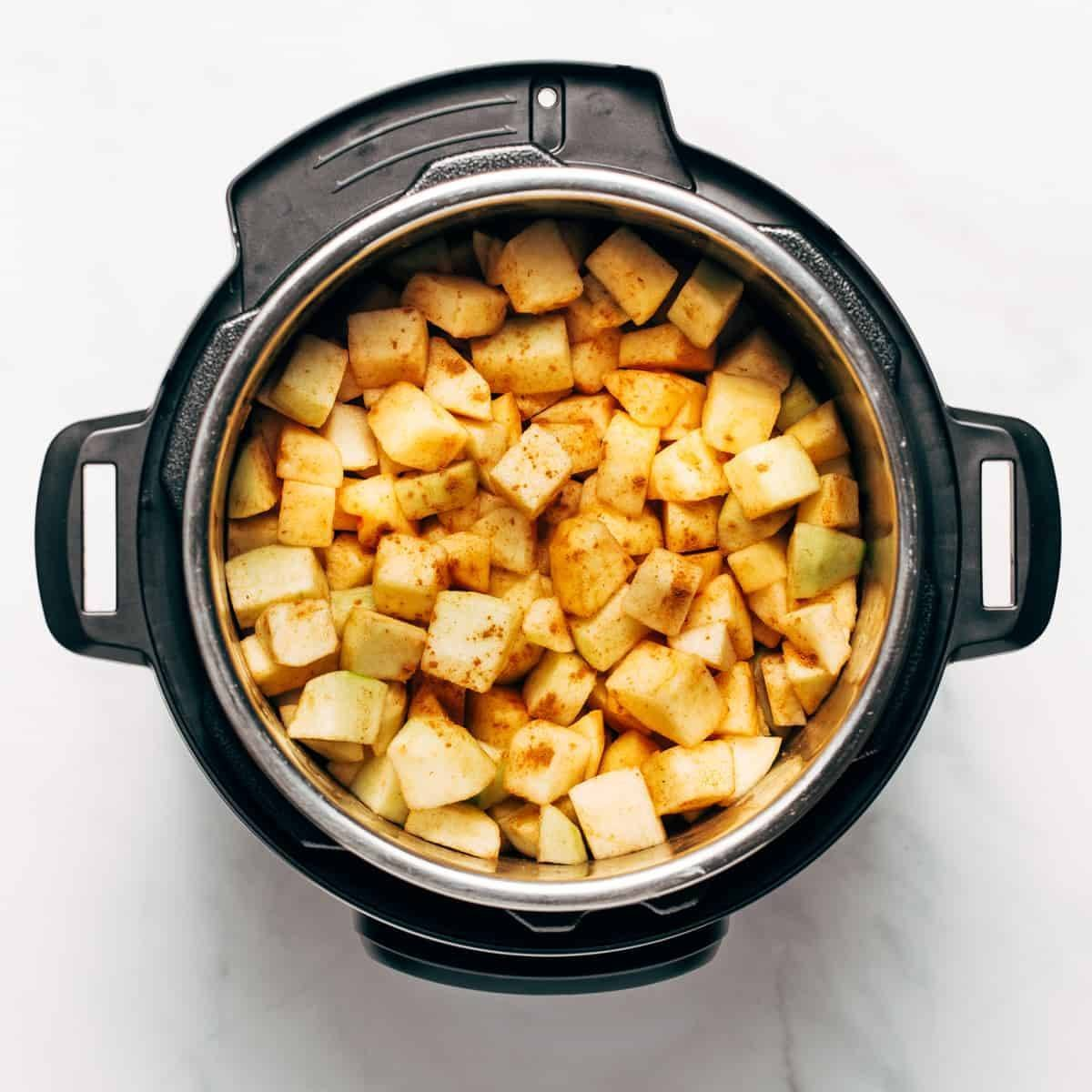 Green apples chopped and in an instant pot with spices