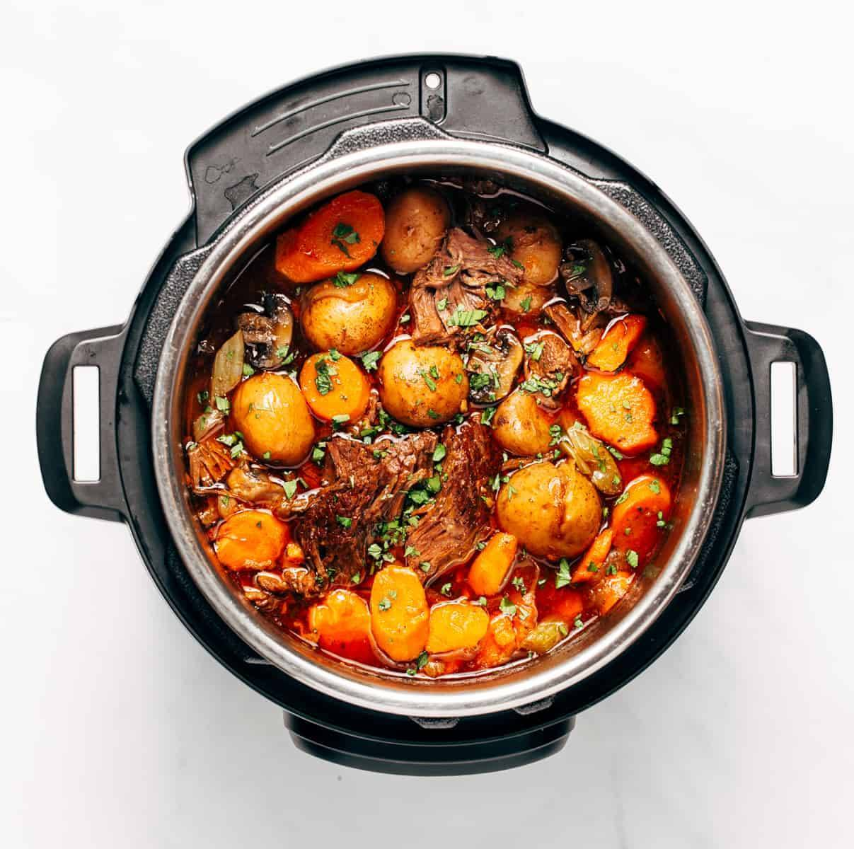 Stewed potatoes, meat, mushrooms, spices, and onions in an instant pot