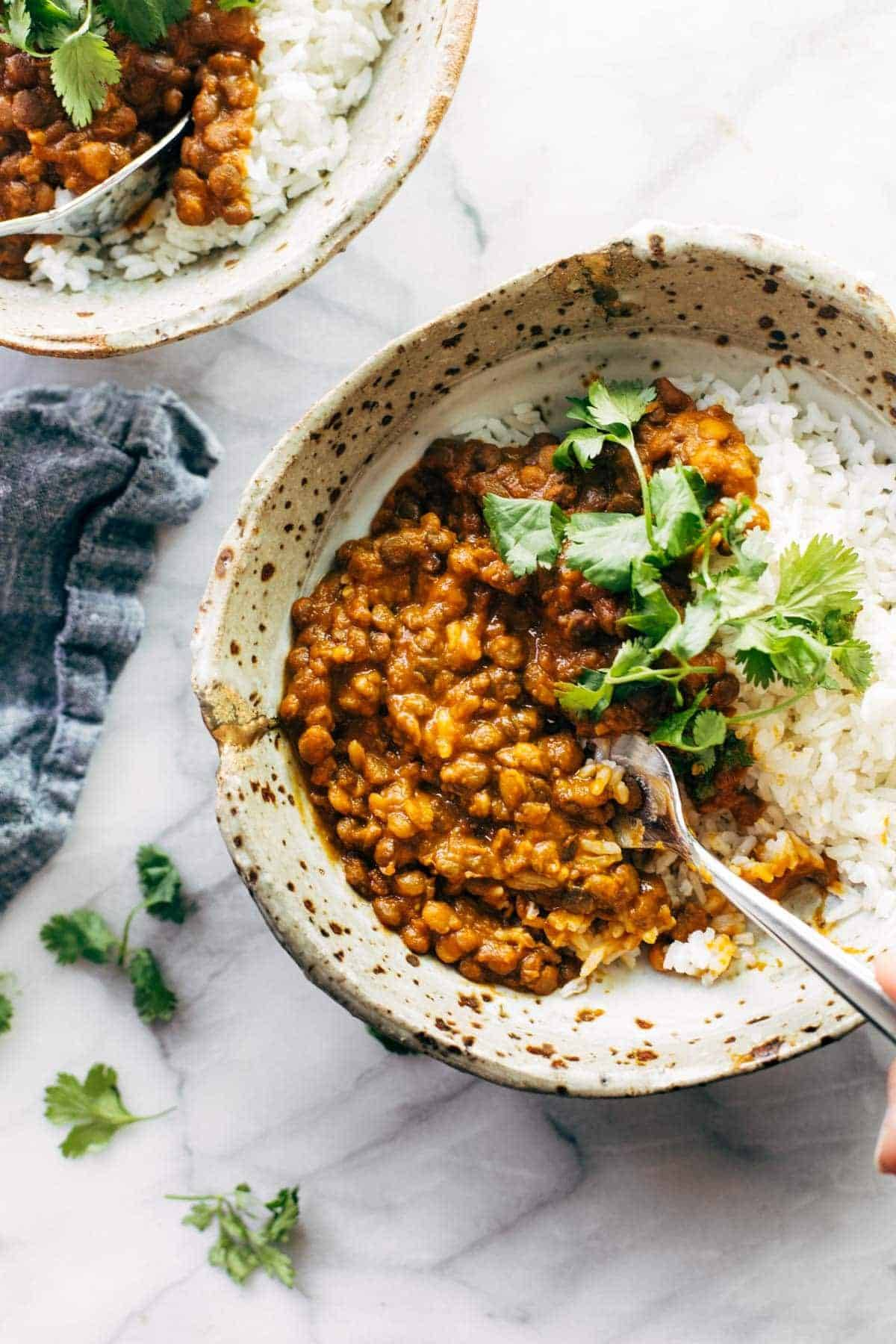 Red curry lentils in a bowl with rice.