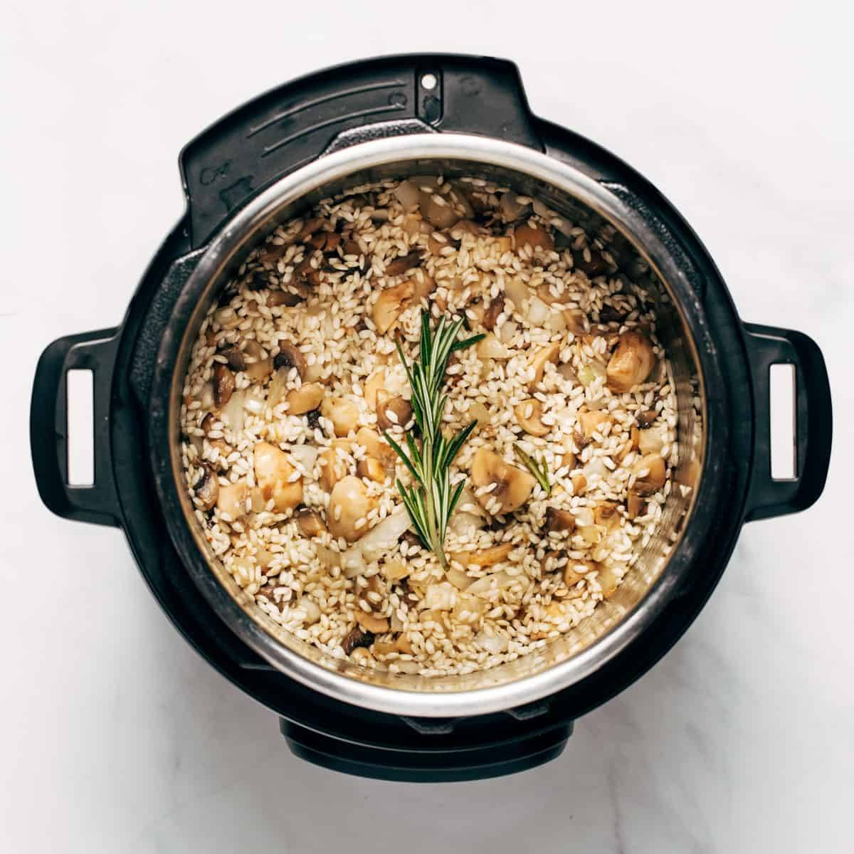 Risotto ingredients in an instant pot
