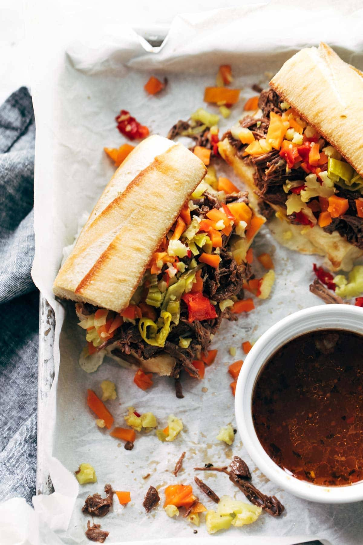 Instant Pot Italian Beef in sandwiches on a tray.