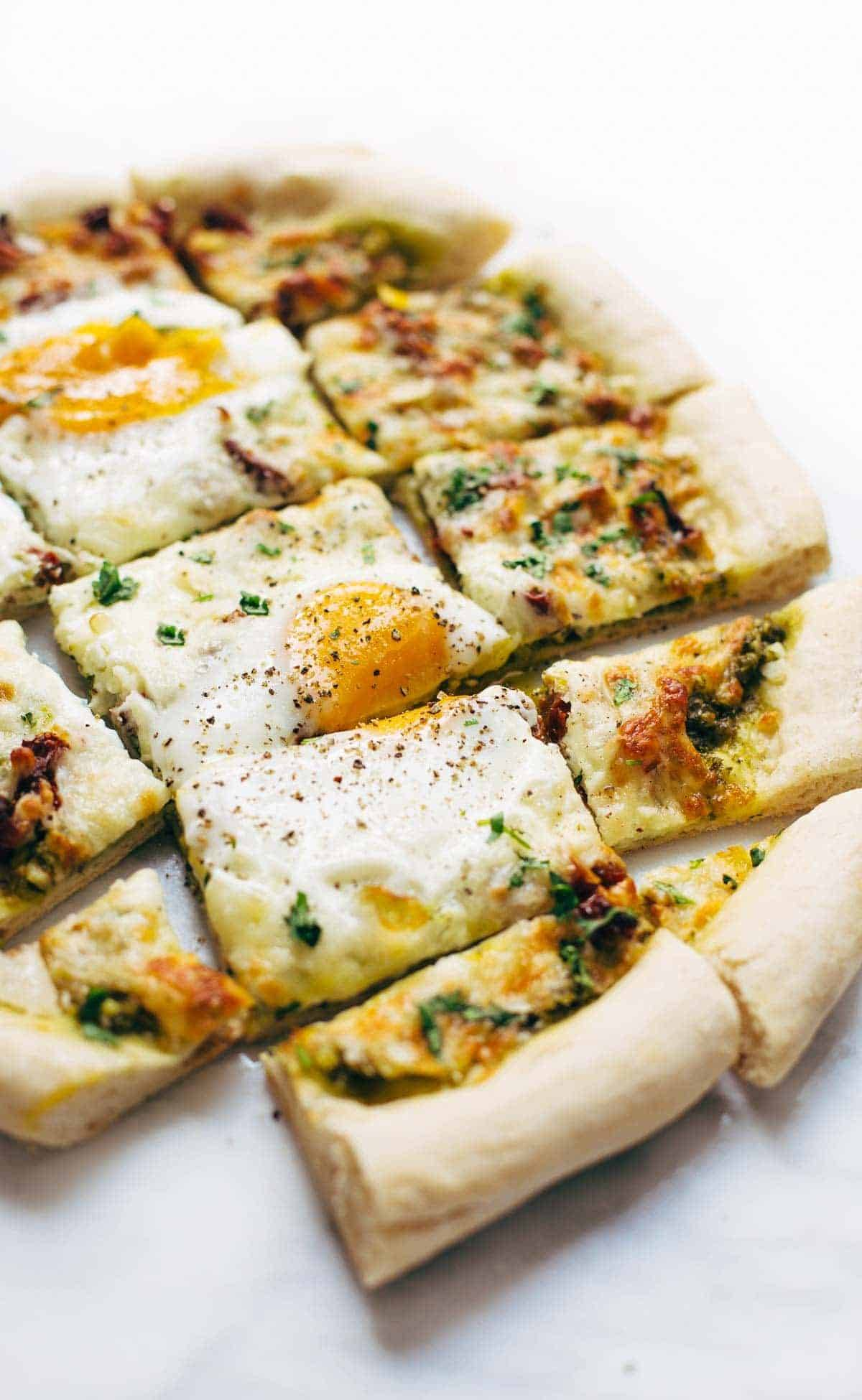 Breakfast Pizza cut into squares.