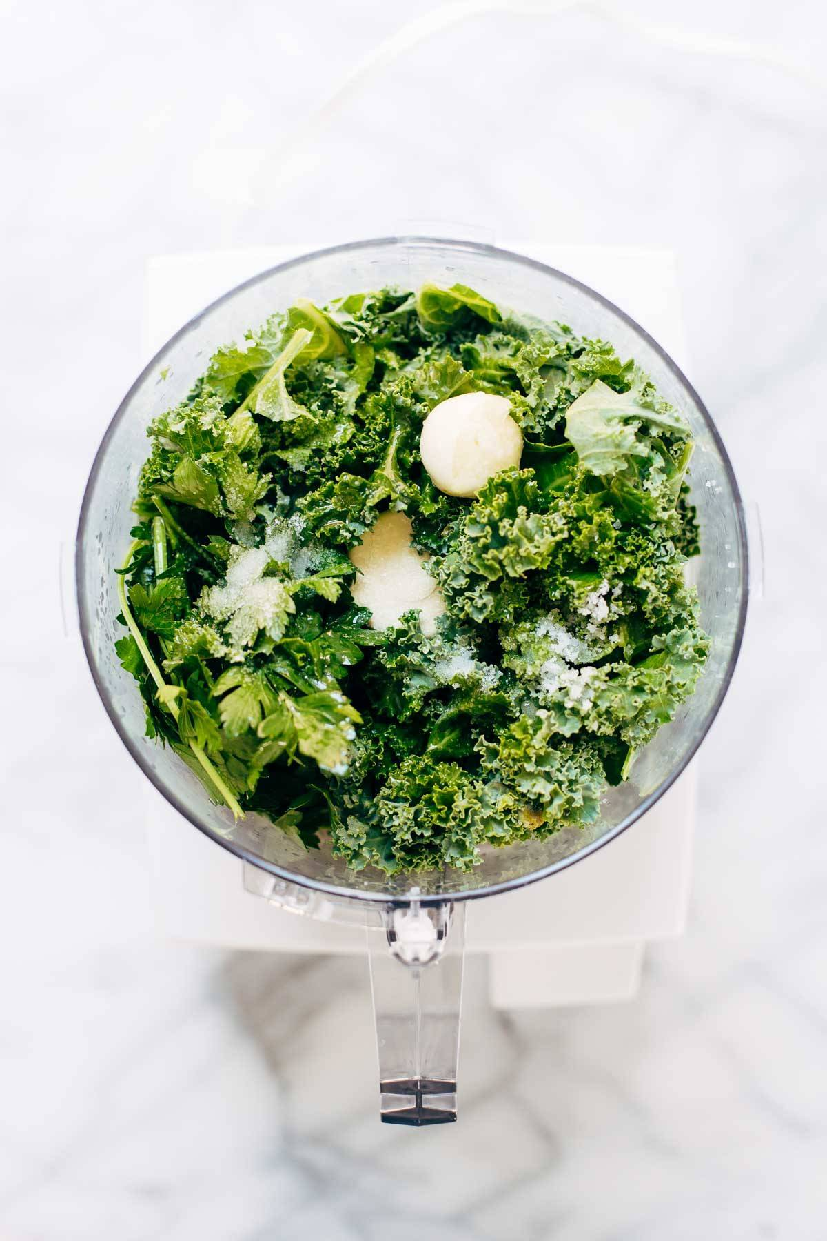 5 Minute Vegan Kale Pesto - made with almonds, olive oil, kale, garlic, salt, and lemon juice. Less than 150 calories per serving! | pinchofyum.com