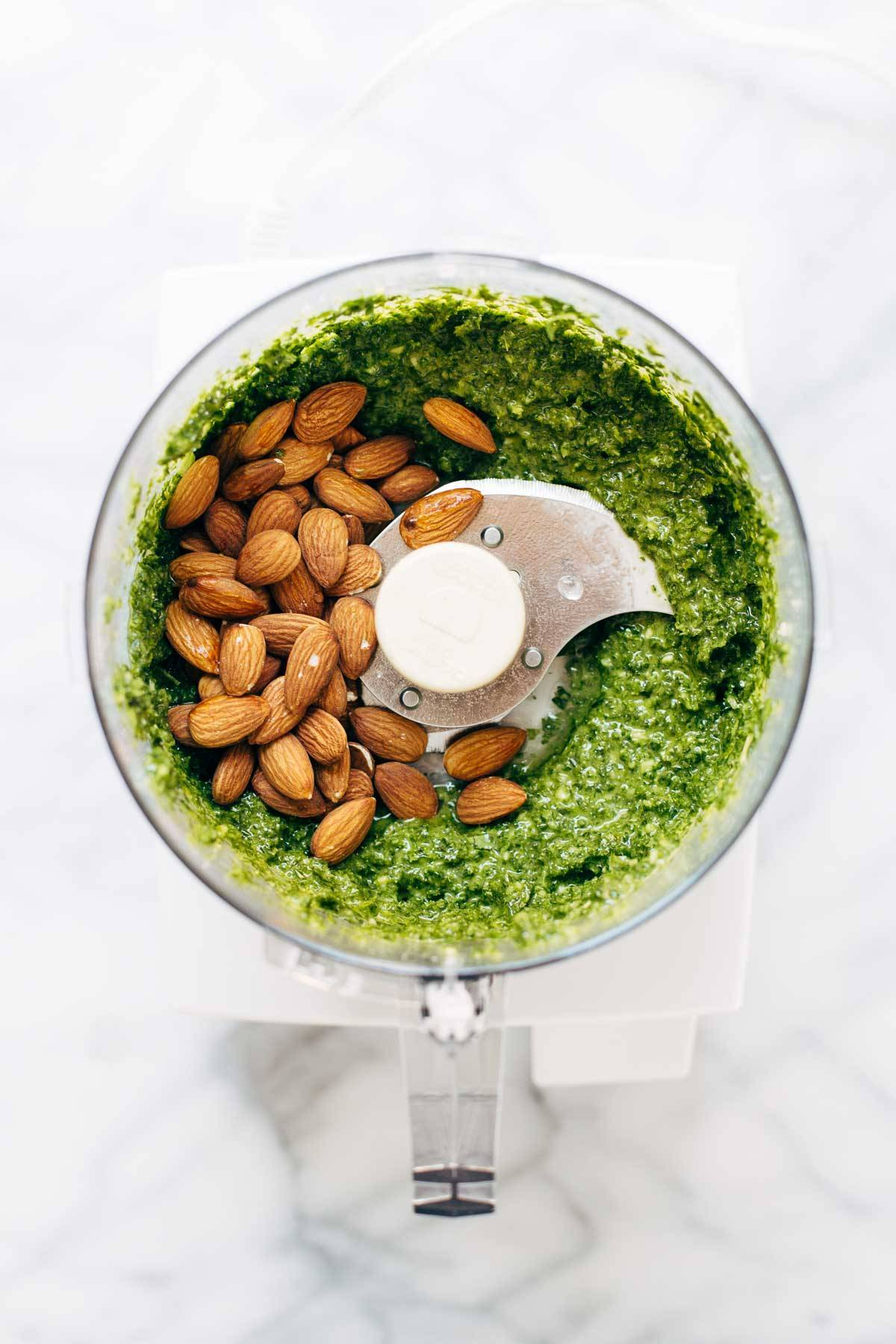 Kale pesto and almonds in a food processor.