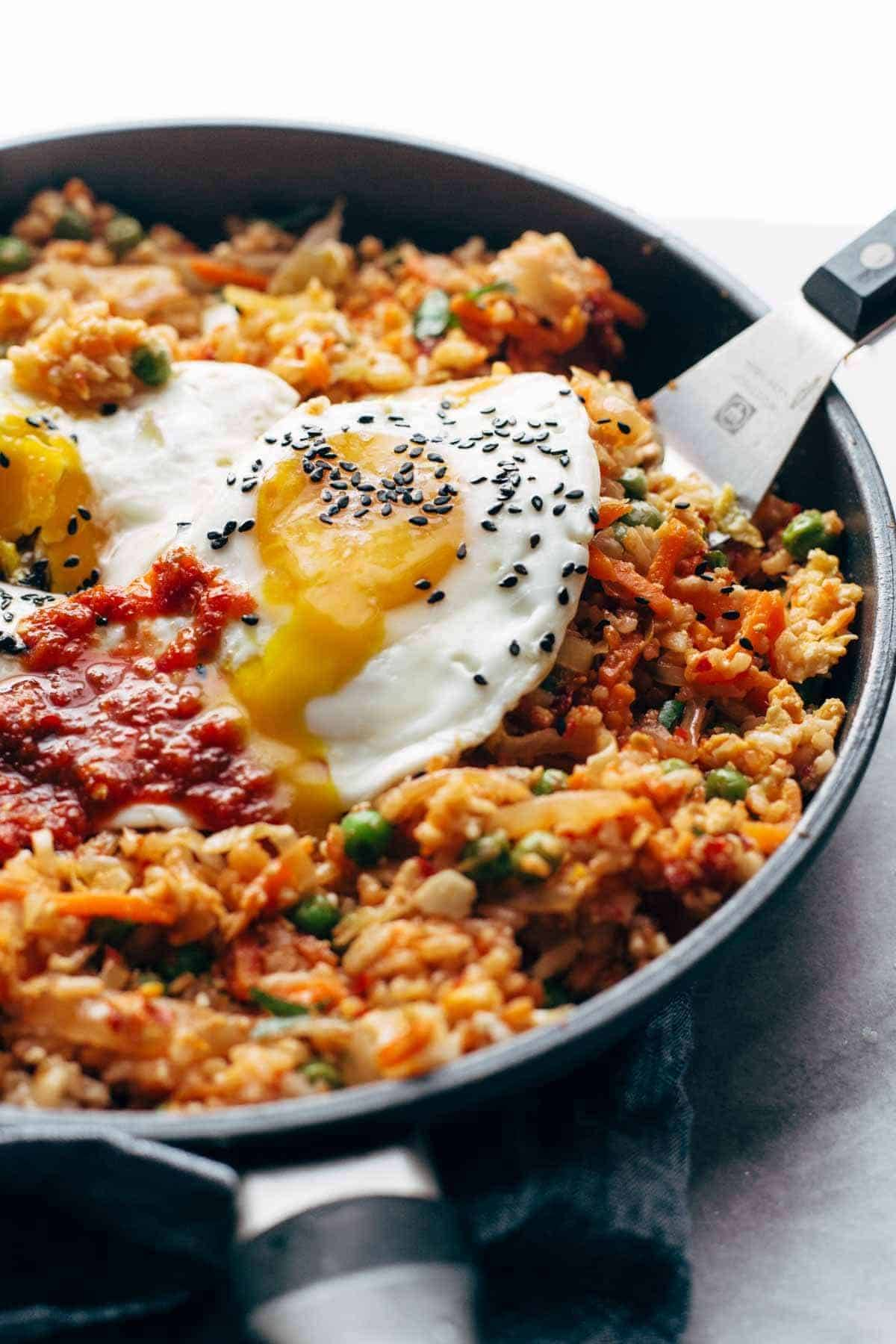 Kimchi fried rice in pan with egg.
