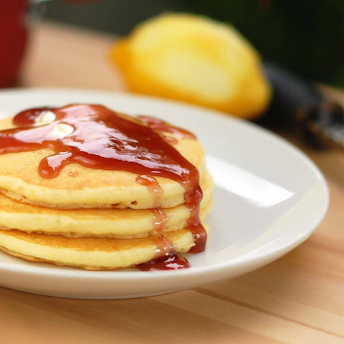 Amazing Lemon Pancakes that are light, fluffy, and easy to make topped with a blackberry syrup made from blackberry jam. Delicious for a weekend brunch! | pinchofyum.com