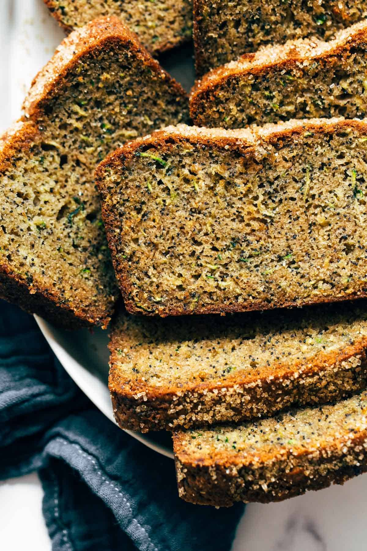 Lemon Poppyseed Zucchini Bread stacked on a plate.